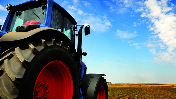 The Tractor - modern farm equipment in field